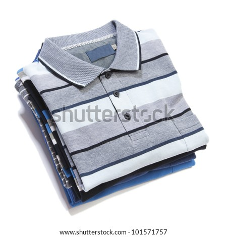 Pile of multicolored knitted man polo clothes - stock photo