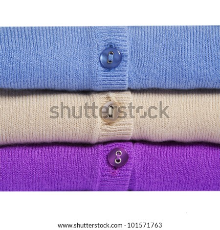 Pile of multicolored knitted women clothes macro - stock photo