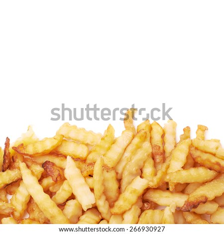 Pile of multiple wavy french fries isolated over the white as a copyspace background composition - stock photo