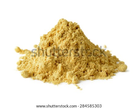 Pile of mustard powder isolated on white background - stock photo