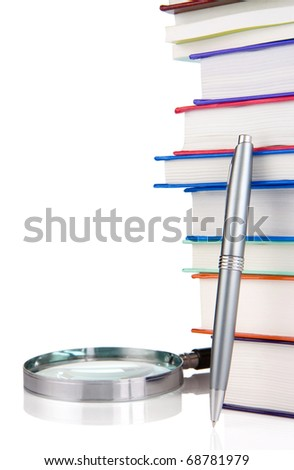 pile of new books, pen and magnifying glass isolated on white background - stock photo
