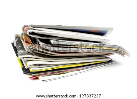 Pile of newspapers and magazines isolated on white background - stock photo
