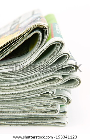 pile of newspapers  isolated on white background - stock photo