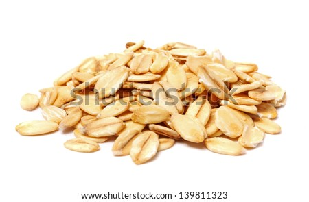 pile of oatmeal isolated on white background - stock photo