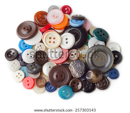 Pile of old and used clothes buttons isolated on white background - stock photo