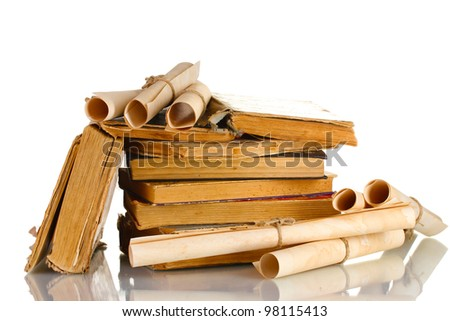 Pile of old books and scroll isolated on white - stock photo