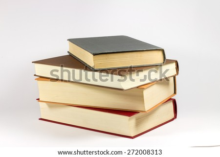 Pile of Old Books on White Background. - stock photo