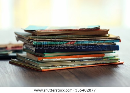Pile of old books on wooden table - stock photo