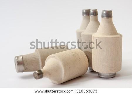 Pile of  old ceramic fuses. - stock photo