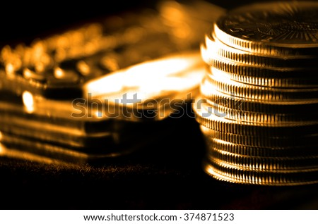 Pile of old coins and bullion with dark background  - stock photo