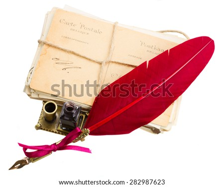 pile of old mail with inkwell  and red feather pen isolated on white background - stock photo