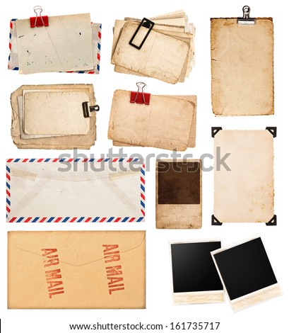 pile of old postcards isolated on white background. vintage paper sheets with clip. old photo frames. air mail envelope. retro design - stock photo
