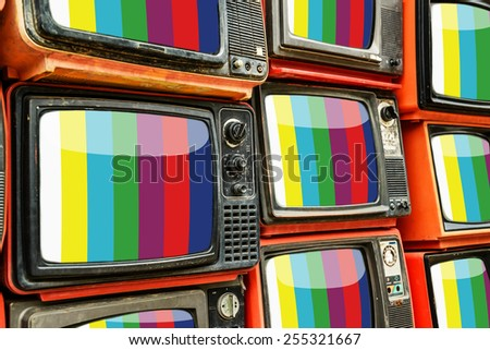 Pile of old red retro TV - stock photo