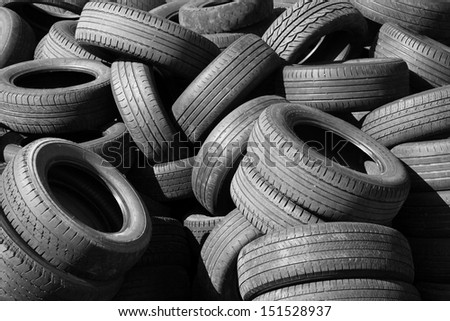 Pile of old used automotive tires - stock photo