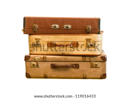 Pile of old vintage bag suitcases on isolate background - stock photo