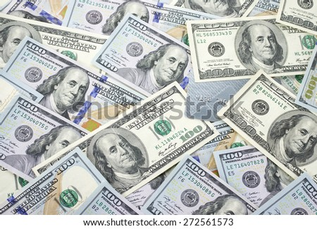 Pile of one hundred dollar bills and plastic card. Top view point. - stock photo
