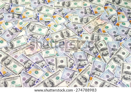 Pile of one hundred dollar bills new and old design and fifty dollar bills. - stock photo