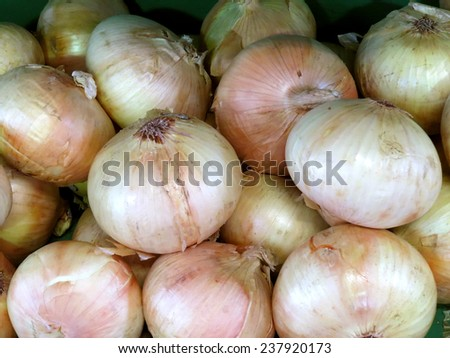 Pile of onions from farmers' market - stock photo