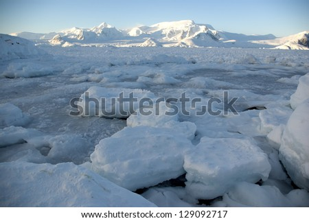 Pile of pack ice in the Strait off the Antarctic Peninsula. - stock photo