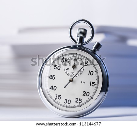 Pile of paper cards and stopwatch - stock photo
