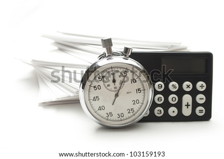 Pile of paper cards, calculator and stopwatch - stock photo