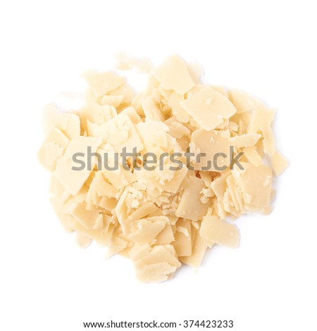 Pile of parmesan cheese flakes - stock photo