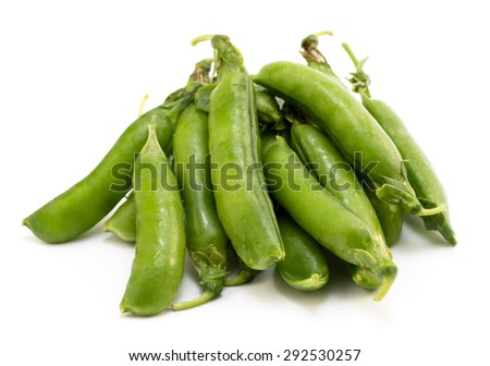 Pile of pea pods isolated on white - stock photo