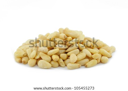 Pile of pine nuts in isolated white background - stock photo