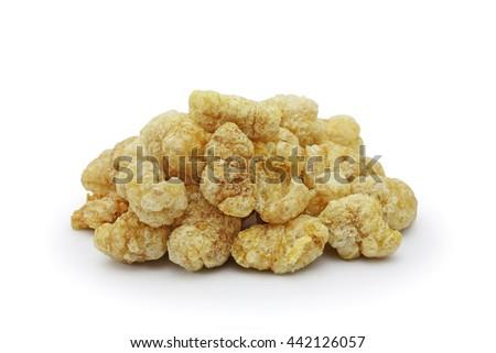 Pile of pork rind isolated on white background  - stock photo