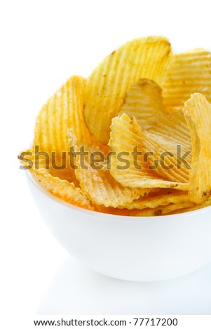 Pile of potato chips in a white bowl. - stock photo