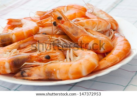 Pile of prepared shrimps on the plate - stock photo