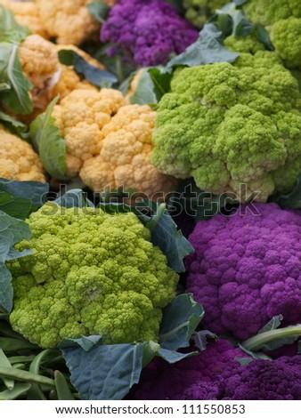 Pile of Purple Green Orange Cauliflower at the farmers market - stock photo