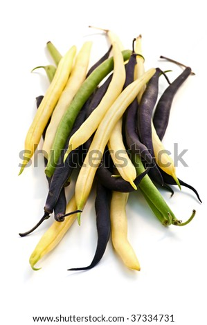 Pile of purple yellow and green string beans isolated on white - stock photo