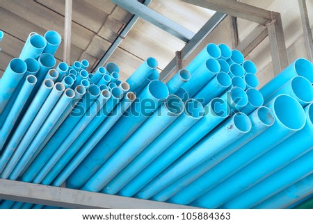 Pile of PVC pipes in warehouse - stock photo