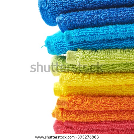 Pile of rainbow colored towels isolated - stock photo