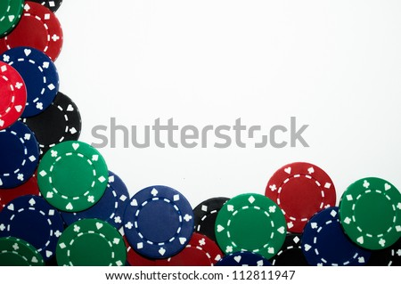 Pile of red, green, black, and blue poker chips isolated on white background - stock photo