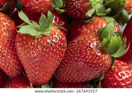 Pile of red strawberries close up background - stock photo