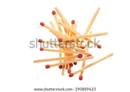 Pile of red wooden matches isolated on white background - stock photo