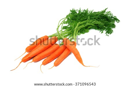 Pile of ripe carrots with green tops isolated on white background - stock photo