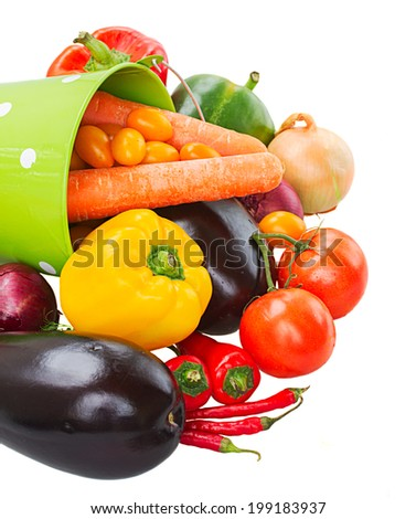 pile of ripe vegetables in green pot - tomatoes, onion, peppers, pumpkin and eggplants - stock photo