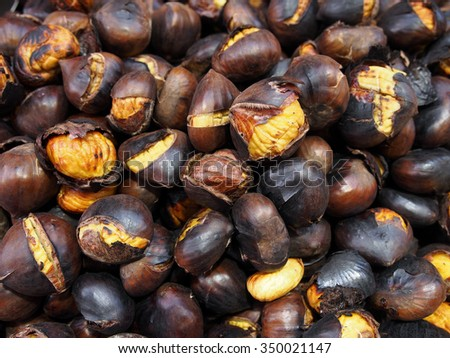 Pile of roasted chestnuts. - stock photo
