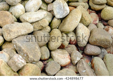 Pile of rocks or stones on coastline beach for concept background - stock photo