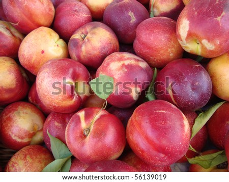 pile of Rose Diamond Nectarines on display at a farmers market in San Francisco - stock photo