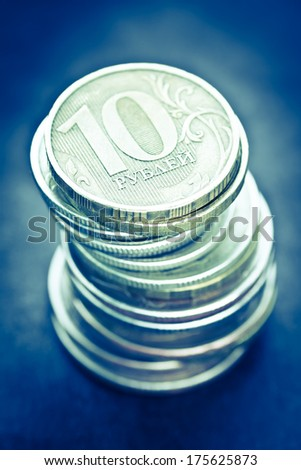 Pile of russian coins on a dark background. Selective focus with shallow depth of field. Color toned image.  - stock photo