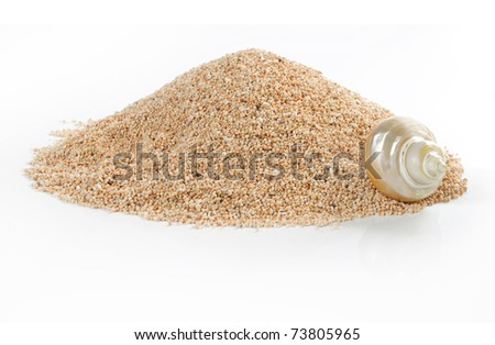 Pile of sand and shell isolated on white - stock photo