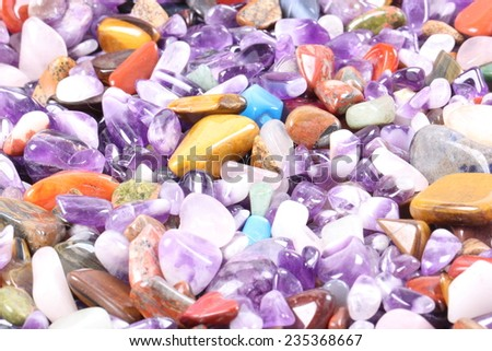 pile of semi precious jewelery stones closeup - stock photo