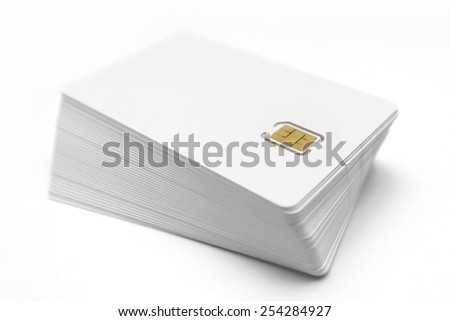 Pile of SIM cards on white background - stock photo