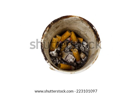 Pile of smoked cigarettes in an ashtray isolated on white background. - stock photo