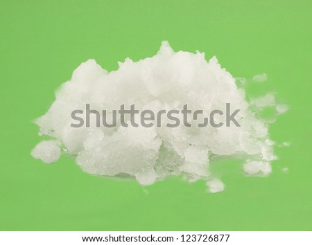 pile of snow on a green background - stock photo