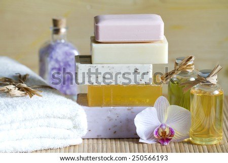 Pile of soaps with cosmetics for spa and body care - stock photo